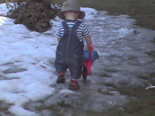 small child playing in the snow