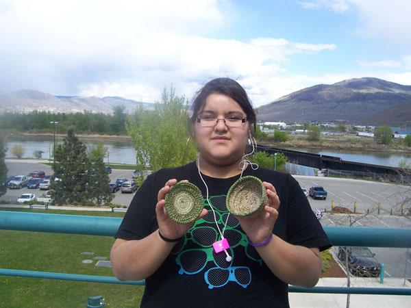 Youth with baskets made at Kamloops training session