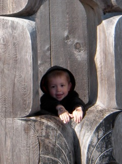 Boy in totem at Haida Gwaii